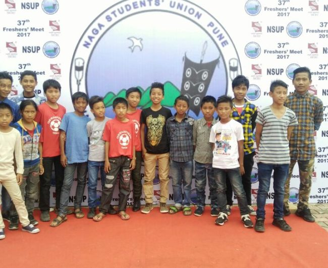 Ishwarpuram children at Symbiosis Nagaland Students association posing for a group photo